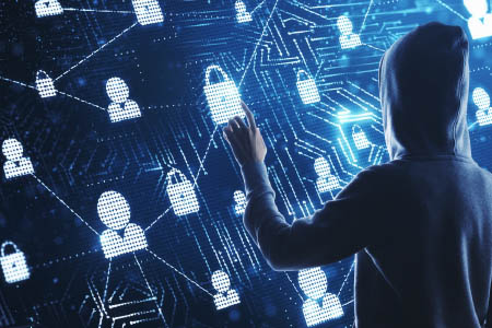 stereotypical hooded hacker entering data breaches