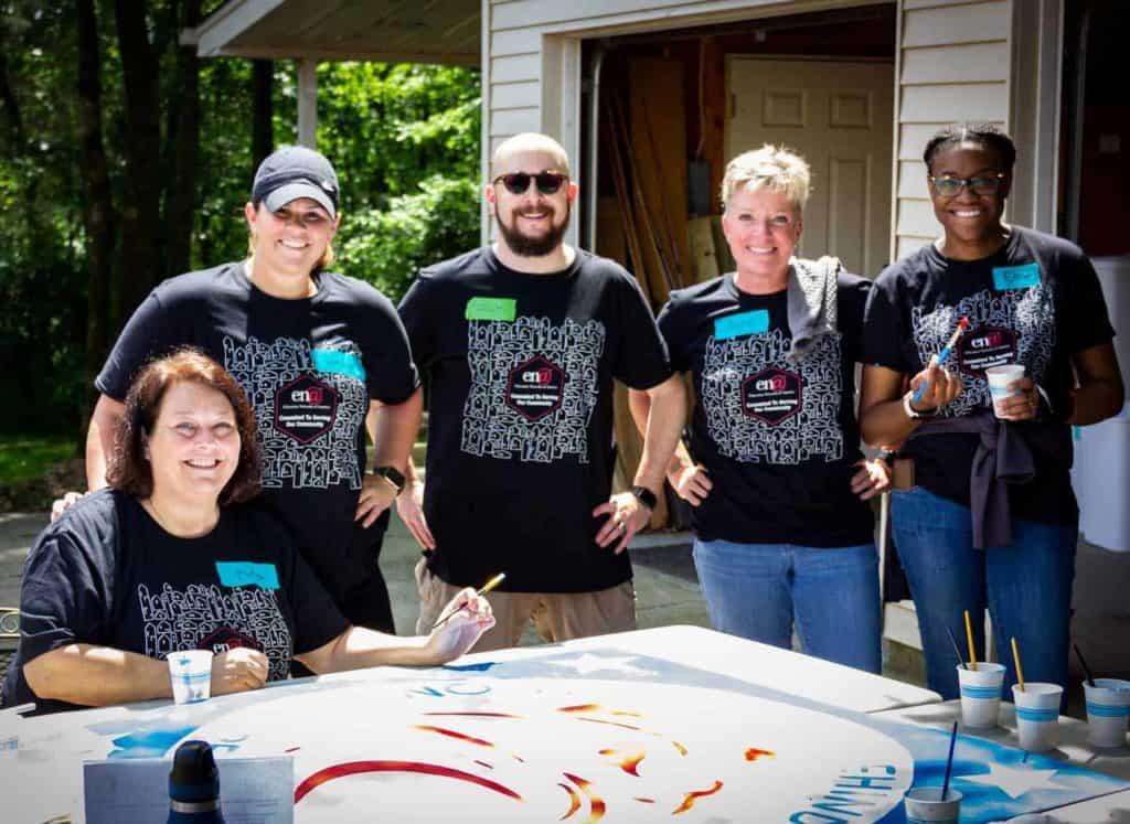 ENA team members painting sign