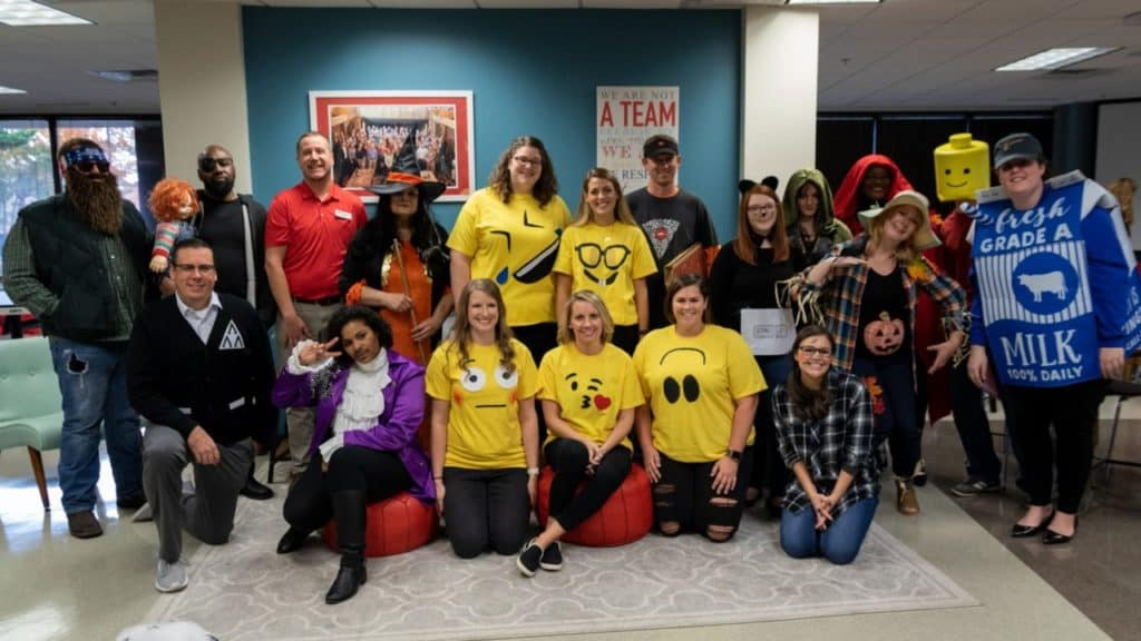 ENA team group photo wearing costumes