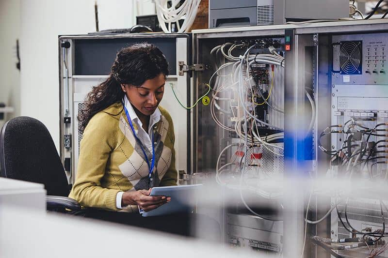 Woman working in server stack