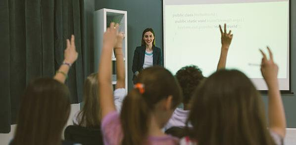 Woman giving a presentation to a classroom