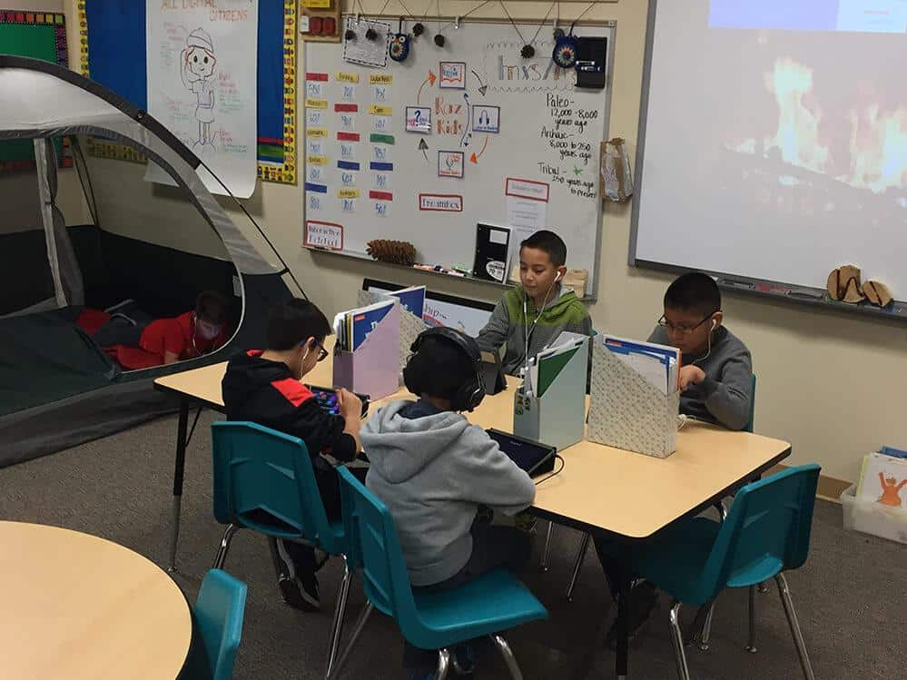 students engaged with technology learning